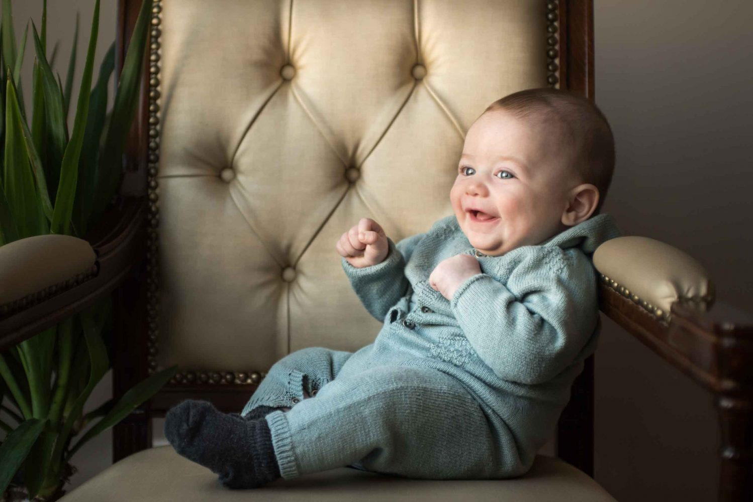 Photograohy session in Brooklyn NY of little boy on a chair with natural light taken by Picadilly Studios