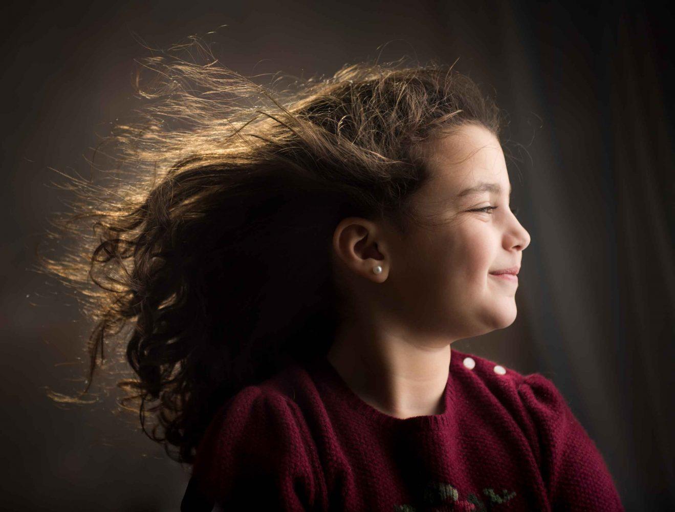 portrait of a girl with windblown hair in studio by Ruchy Oberlander in Boro Park, Kensington, Brooklyn, NY