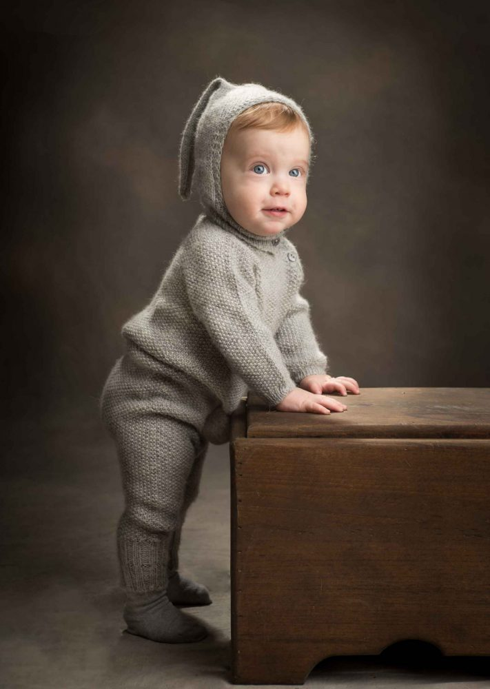 baby boy in bunny outfit during a fun and relaxed photo session by Picadilly Studios in Kensington, Boro Park, Brooklyn, NY