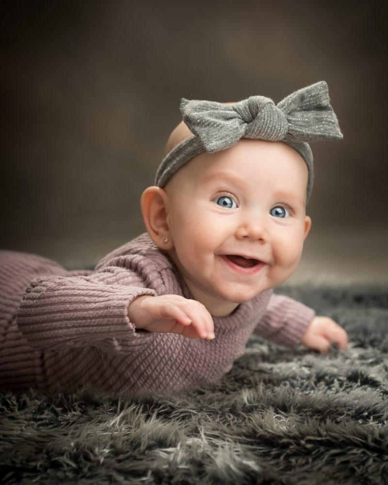 Happy baby girl in studi during milestone photo session by Sara Oberlander of Picadilly Studios in Brooklyn NY
