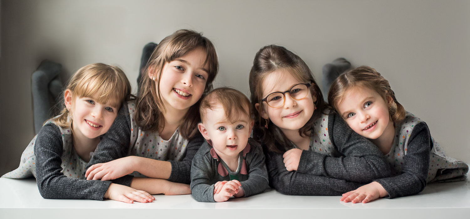 In Brooklyn NY, adorable little girls in home portrait
