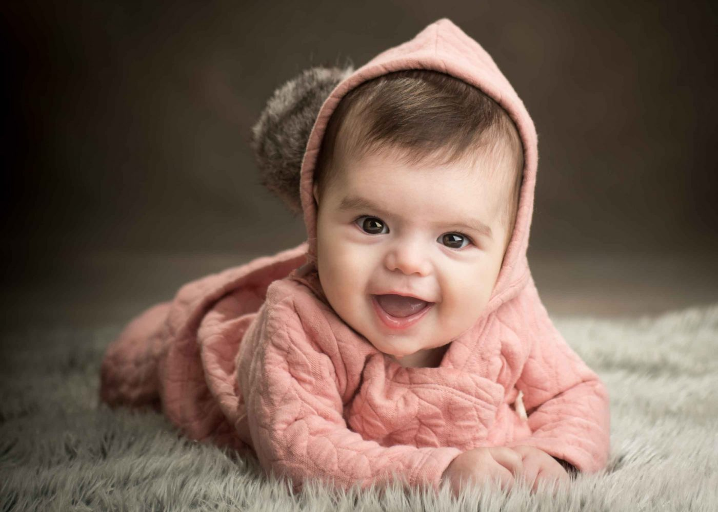 Baby girl with bonnet and matching ooutfit in Picadilly Studios for photo session in Boro Park, Brooklyn, NY