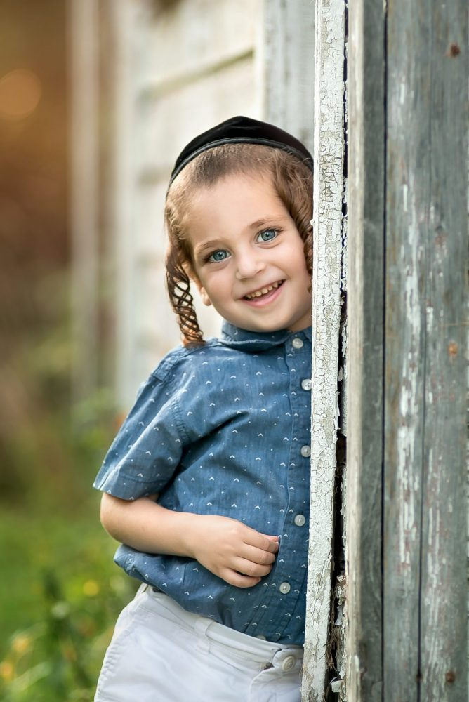Portrait of little boy taken outdoor in late evening by Picadilly Studios of Brooklyn NY